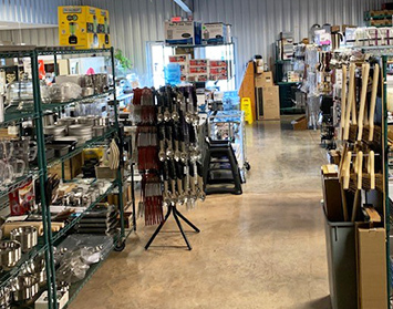 CARE Sales & Service, showroom full of pots, pans and other commercial kitchen utensils.